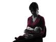 woman feeding bottle baby  silhouette