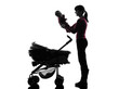 woman prams holding baby silhouette