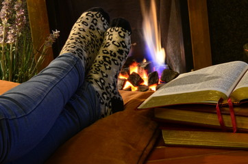 Warming feet by fire in the study