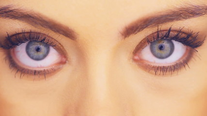 Wide blue eyes of a beautiful woman