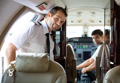 Pilot Entering Private Jet - 59083572