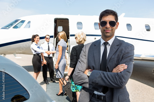 Confident Young Businessman At Airport Terminal