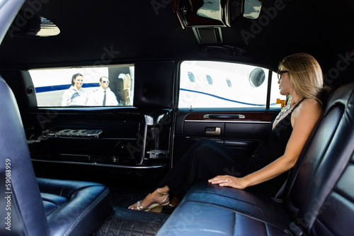 Woman In Limousine At Airport Terminal - 59083959