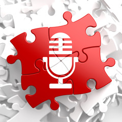 Microphone Icon on Red Puzzle.