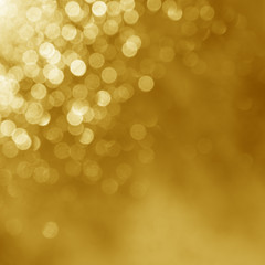Gold lights background Beautifull shine of a holiday light