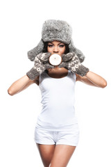 African beautiful girl in winter hat and mittens with coconut.