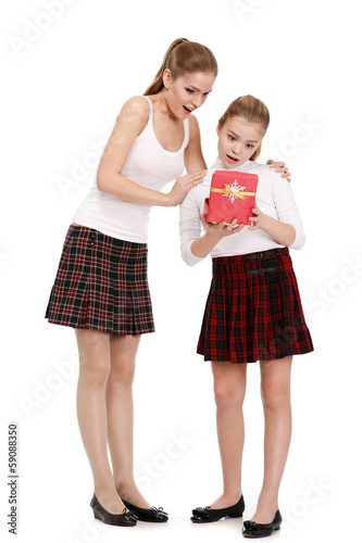 Portrait of sisters with a gift box
