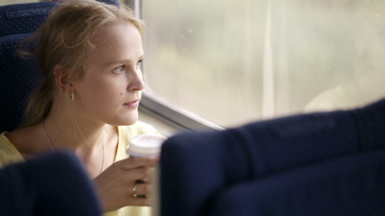 Pensive married woman traveling by train