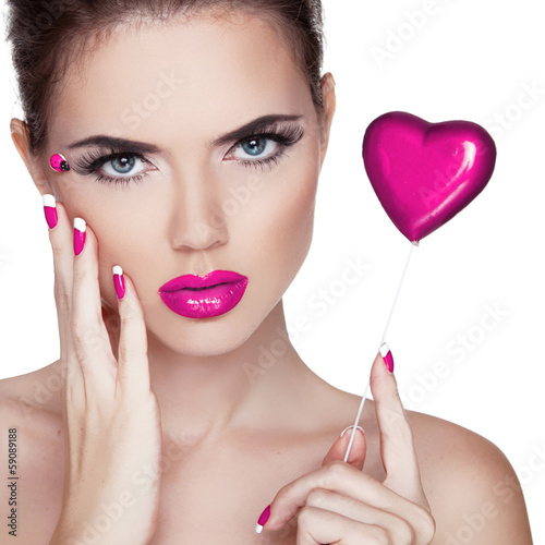 Bright makeup. Beauty Portrait. Beautiful  Woman Touching her Fa