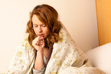 Sick woman cough in ved under blanket
