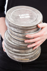 Holding Pile of Film Cans