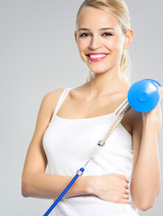 Woman exercising with dumbbells and growth