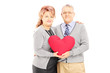 Loving middle aged couple holding a red heart