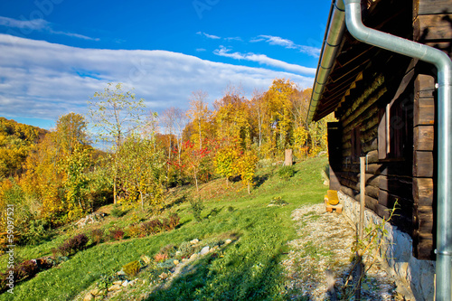Wooden lodge in autumn mountain nature