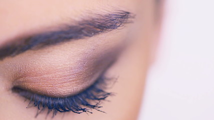 Closeup of a female eye with eyeshadow