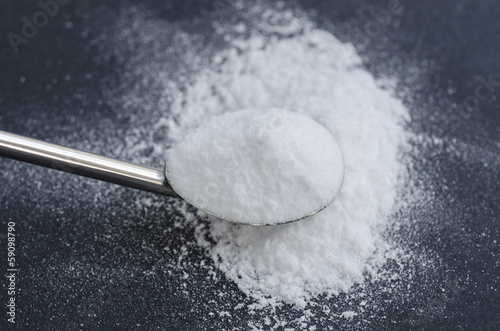 Sodium bicarbonate in a spoon