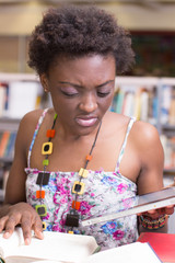 Black student using her tablet while studying