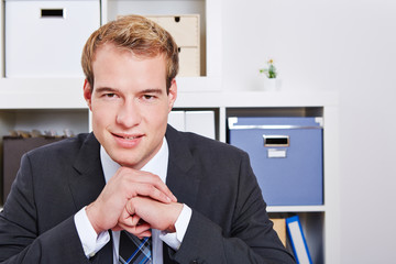 Smiling business man in office