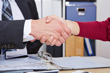 Woman making handshake with business man