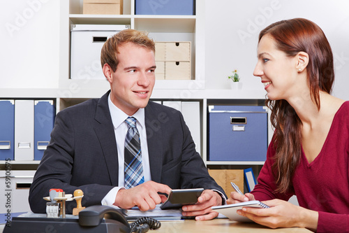 Woman talking to tax consultant