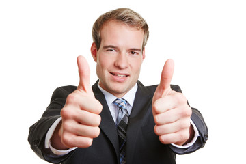 Business man holding both thumbs up