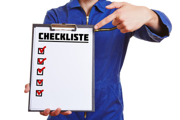 Hand of a worker showing checklist