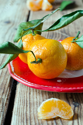 Fresh tangerine on a wooden table