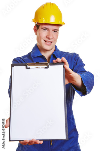 Construction worker offering clipboard