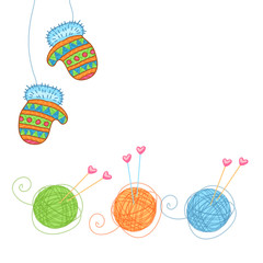 Winter mittens, balls of yarn and needles