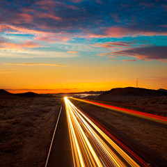 Arizona sunset at Freeway 40 with cars light traces