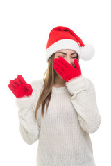 Sleepy young woman wearing Christmas hat and gloves