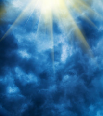 Stormy clouds background with rays of sunshine