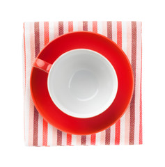 Red coffee cup over kitchen towel