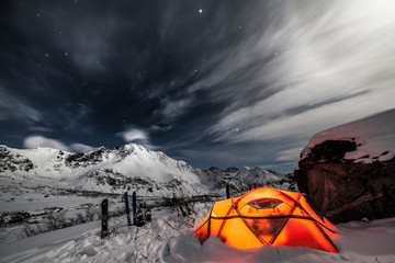 Tent among winter mountains. Stock image