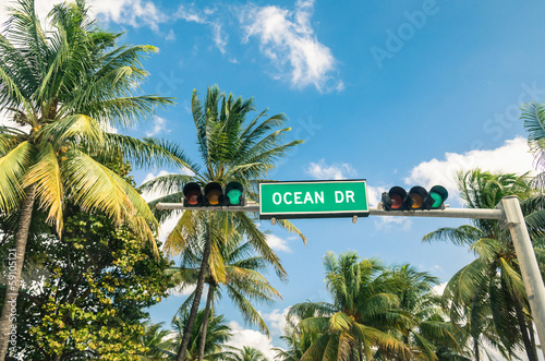 Ocean Drive in Miami - Road sign and green Traffic Light - 59105121