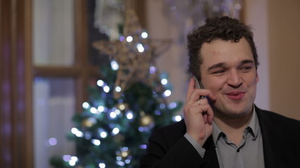 Young man smiling while talking on the phone
