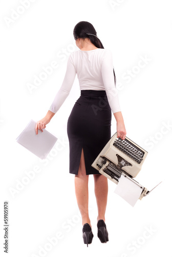 Brunette girl with a typewriter on a white background.