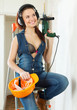 Sexy  girl in headphones with tools