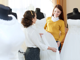 pretty bride chooses bridal dress