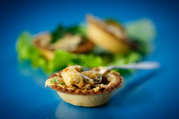 baked tartlets with mushrooms and cheese