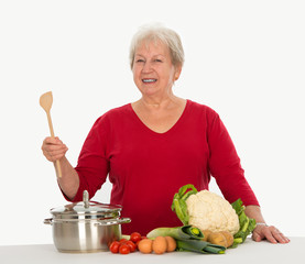 elderly woman is cooking