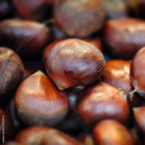 Raw chestnuts background close up macro square