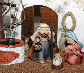 Jesus Joseph with the beard and the stick and Mary in a manger o