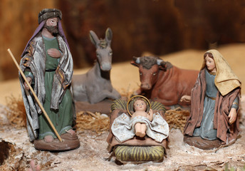 Nativity scene with Jesus, Joseph and Mary in a manger on Christ