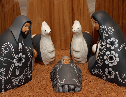 Nativity scene with characters dressed in black