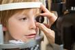 Optician's Hand Examining Boy's Retina