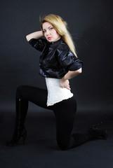 Beautiful girl blonde in white êàðñåòå and black shirt