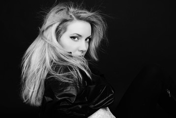 Beautiful girl blonde in  black shirt