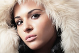 Fashion portrait of young beautiful woman with fur. winter style