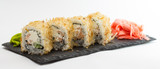 Sushi roll on stone plate isolated on white background